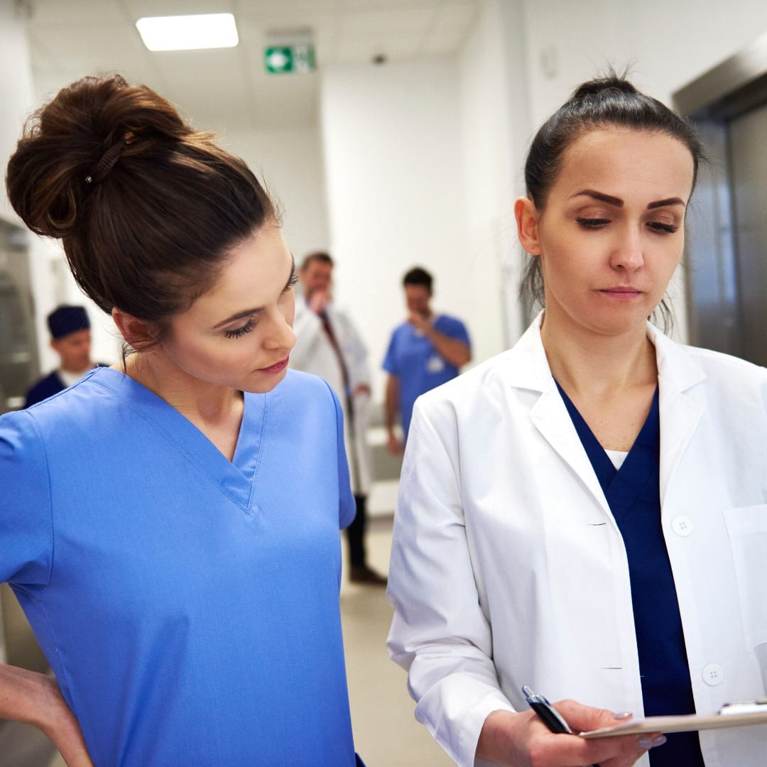Doctor and nurse looking at a file while in a hospital