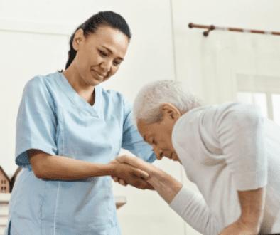 Caregiver helping elderly patient