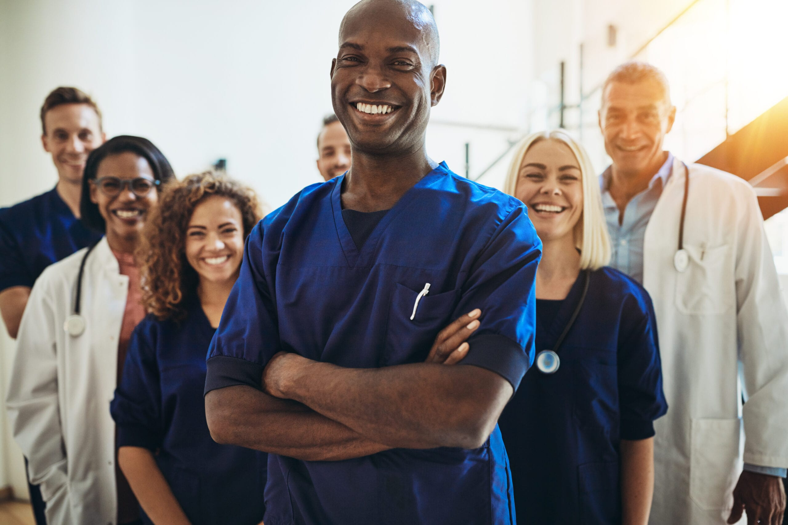 Nurse standing in a hospital with crew