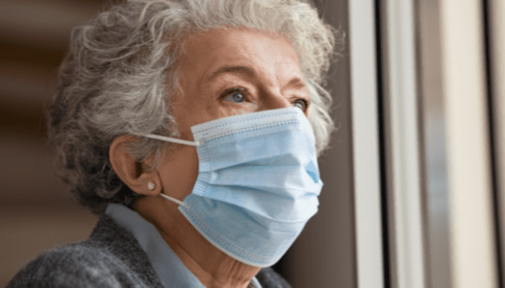 Elderly woman wearing a mask depression in seniors
