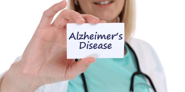 A nurse holding a card that says Alzheimer's Disease for Alzheimer's care