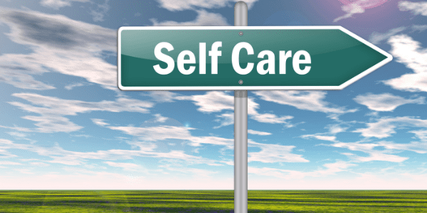 "caregiver guilt Road sign saying ""self-care"""