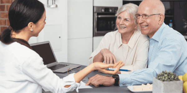 Senior Care Planning by an elderly couple sitting at a desk